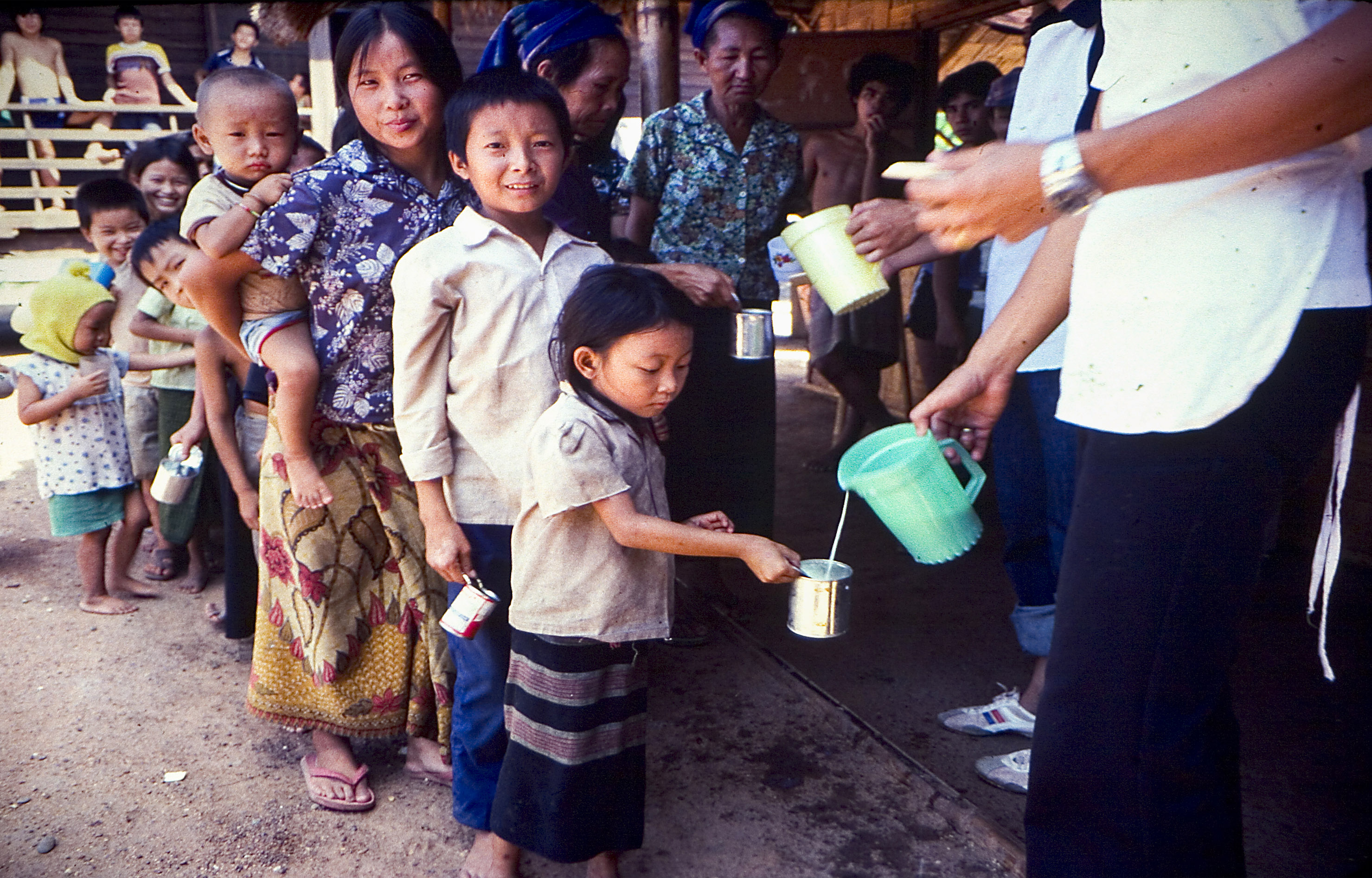 Refugees receiving food at Thai refugee camp.